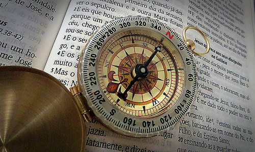 Compass on a Bible