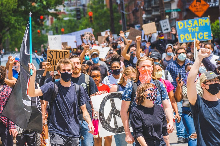 People Marching Through A City Seeking Justice For George Floyd